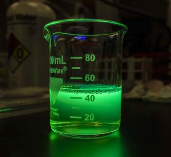 Beaker containing green fluorescent protein